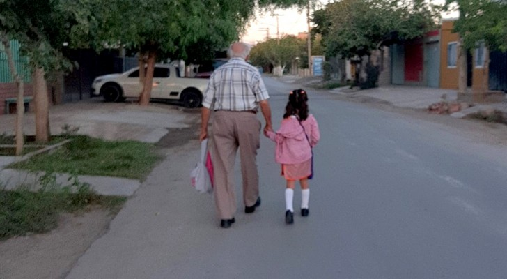 A great-grandfather accompanies his granddaughter to her first day of school: the tender photo that went around the world