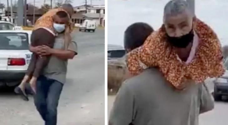 Er trägt seine behinderte Mutter auf den Schultern, um sie zum Covid-Impfzentrum zu bringen: ein Mustersohn