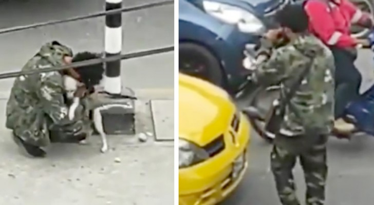 A poor guy hugs his little dog after performing in front of a traffic light: he was heartbroken and desperate