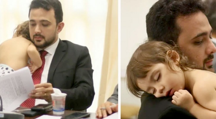 He holds his daughter in his arms during a business meeting: the photo of this caring dad moves the web