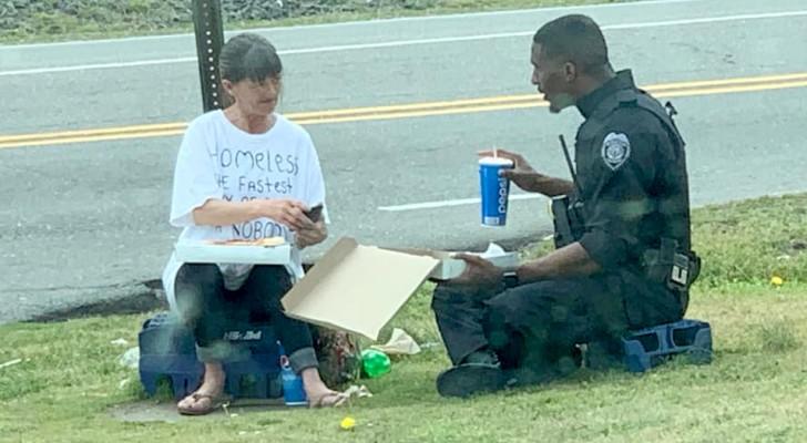 Deze foto van een politieagent die een pizza koopt en deelt met een dakloze gaat viraal