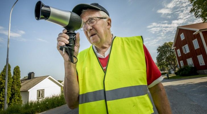 Elderly man uses a hair dryer as a speed camera to slow down cars that are going too fast