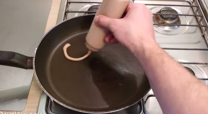 He starts with pancake mix and creates the easiest pancake shape i've ever seen. Wow!