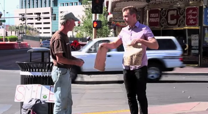 A man rips up the sign of a homeless guy, but what he's about to do, will make him smile!