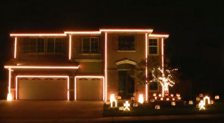 It may seem like a normal light show for the holidays, but look at the top window ...