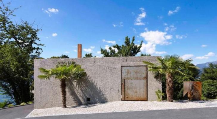 Achter deze betonnen muren en de roestige poort gaat een spectaculair huis schuil