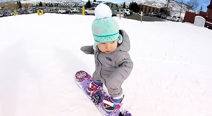 He learned to walk only a few weeks ago ... But when he gets on a snowboard? Phenomenal!