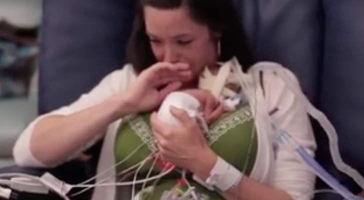 Born 3 1/2 months premature and weighs 1.5 lbs -- The first embrace with his mother is so touching!
