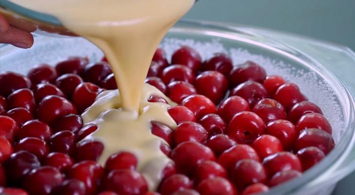 Ze schenkt beslag over een laag verse kersen en creëert hiermee een overheerlijk en onweerstaanbaar dessert!