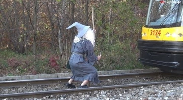 A madman dressed as Gandalf stops a Tram